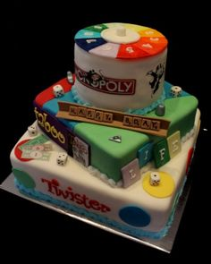 This creation by Cake Central user Jewelld Cakes features elements from The Game of Life, Monopoly, Scrabble, Taboo and Twister