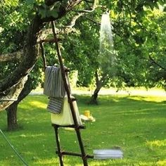 Rain Forest If you lack plumbing skills but have a good sturdy tree, here's the easiest outdoor shower solution of all: Simply attach a shower head to your garden hose and drape it over a branch, just like SweetPaul did here. Don't forget a vintage ladder as a rustic towel rack!