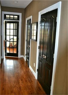 love the wall color, white trim, and black doors