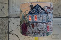 Marna lunt  Hand embroidered lampshades, lit up windows