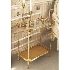 Want this or something similar (a gold bar cart) for my dining room. This is Golden Bamboo Two-Tier Foldable Antiqued Mirror Tray Table