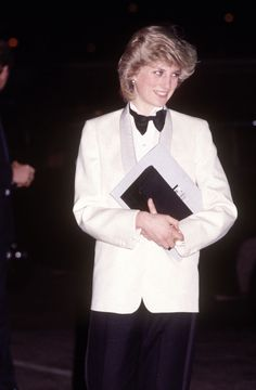 Princess Diana-SHARP TUXEDO In 1984, Diana surprised her fans when she ditched pretty dresses and sported a white dinner jacket, black trousers and a black bow tie for a charity concert by the band Genesis.