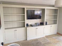 Bespoke TV wall unit. Painted in F&B Bone. Cobwebs Furniture Company.