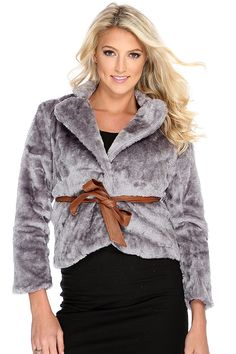 This must have outerwear will take your fall wardrobe to a  whole new level! Turn heads at any glamorous event in this look! Youll sure captivate everyones attention! It features faux fur, collar, long sleeves, button up, belt loops, adjustable waist tie, and fitted. 100% Polyester.