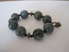 Gorgeous agate heart charm bracelet bracelet. Available at http://www.simplysilverbyrebecca.com/simply-bead-earrings.php