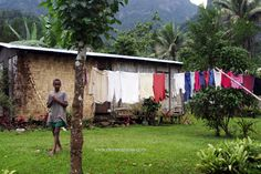Villagers in this remote village on a mountaintop in Fiji hang their clothes to dry on the line. Walking through the houses feels like watching the flags at an Olympic opening ceremony.  The bright colors against the saturated greens and thick vegetation are beautiful.
