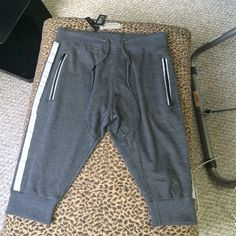 NWT⭐️ Grey and White stripe Joggers⭐️ Adorable Joggers for spring☔️These grey with a grey reflective stipe detailing. Elastic Drawstring waist with 2 front pockets with zip. And one back pocket. These fit slim cut with the cuff to your knee. Depending on how long your legs are. %60 cotton,%40 poly. Made for men. However no way would I envision these on my gorgeous 6'3 son who I originally bought these for. Galaxy by Harvic Pants Track Pants & Joggers