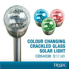"""COLOUR CHANGING CRACKLED GLASS SOLAR LIGHT From Regal  Dazzle guests with a colour-changing glow! Crackled glass garden stake creates a dramatic effect as the bright LED changes from red to blue to green. Solar panel charges by day, to power the light for up to 6 hours at night. Includes rechargeable AA battery. 15-1/2""""H x 3""""Diam.  Product Number - CB54338"""