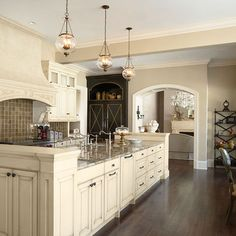 Macadamia by Sherwin Williams and Balsa by Pratt and Lambert on the cabinets