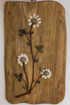 Chamomile - Floral painting achieved by sticking the twigs and pebbles on a rustic plank. The pebble have their natural shape and color, they're not painted.  It is known that chamomile has soothing powers, such as the energy of this arrangement will soothe viewers.