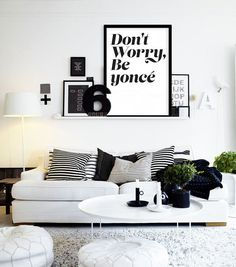 I'm liking the monochrome arrangement and differently sized frames. The Beyonce quote is the cherry on top