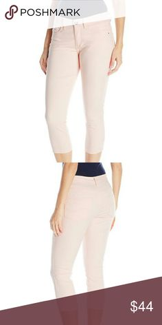 """Easy Fit Capri Jean 75% Cotton, 24% Polyester, 1% Spandex. Machine Wash. Revolutionary slimming stretch denim. Non-restrictive waistband. Sits just below the waist. Rise: 10.25"""", Leg Opening: 15"""", Inseam: 22"""". Product measurements were taken using size 10. Please note that measurements may vary by size. Jeans Ankle & Cropped"""