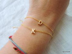 Tiny gold   letter bracelet - Gold  initial bracelet your choice. $14.50, via Etsy. One for each of my sweet peas.