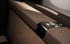 Priestmangoode infotainment interface interior jet plane aircraft train leather brown wood warm