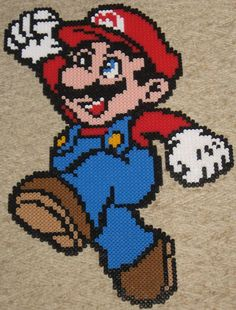 Mario! Mario! Mario! Mario! Mario! *and then Mario's head is somehow the size of all of North America*  Following in my series of awesome huge sprites comes Super Mario. Sprite is from the image gallery of the Gameboy Color's super Mario Bros. Deluxe. I slightly edited and recolored the sprite, tweaking its inherent awesomeness, because I'm awesome.