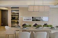 Modern White Dining Chairs With Brown Dining Table Under Rectangular Pendant Lights