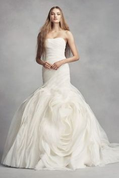 "The dramatic skirt of this White by Vera Wang trumpet wedding dress is handcrafted with over 70 yards of bias-cut organza tiers. Two romantic rosettes complete this classic silhouette. White by Vera Wang, exclusively at David's Bridal 4"" extra length dress Polyester Chapel train Back zipper; fully lined Dry clean Imported Also available in petite and extra length"