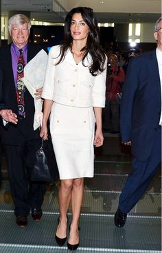 Amal Clooney steps out in a structured white two-piece tweed suit.