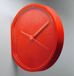 The red Lexon side clock makes a great modern mantel clock or can be hung side-ways on the wall. A stylsih minimalist clock from Clocks with Style.
