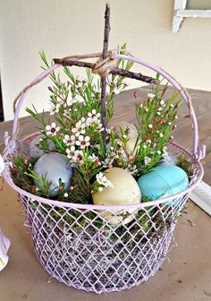 White Wire Basket with Stick Cross and Easter Decorations