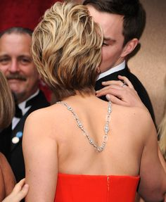 Jennifer Lawrence snuck in a kiss with boyfriend Nicholas Hoult on the Oscars red carpet. Source: Getty / Steve Granitz