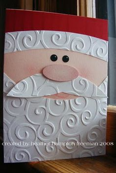 Try this for xmas stocking with couching swirls on beard. Cute Santa card made with CB D'vine Swirl folder