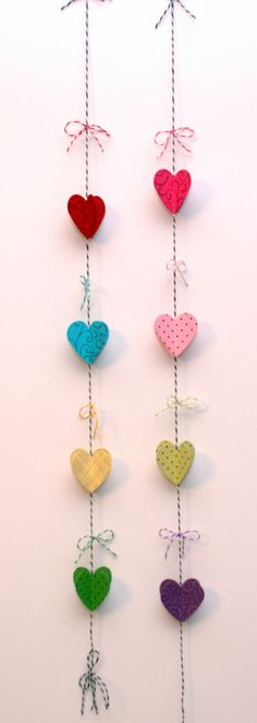 twine heart mobile! love it.  Would be cute with different shapes too.