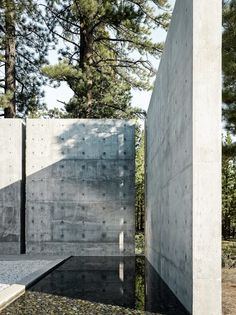 This Concrete Abode Stretches Over Giant Boulders - Photo 3 of 17 - The client requested the design to include a water feature. Instead of a pool that would require tremendous upkeep, the architect was inspired by a pool he saw in Spain to produce a rain channel that is fed by rain and melting snow with a valve that the client can easily control.