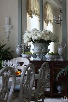 Lovely design with chairs, sideboard and floral