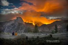 Beautiful but Deadly. Half Dome highlighted by forest fire.   By Nancy Robbins. Robbins photography.com   9/2014