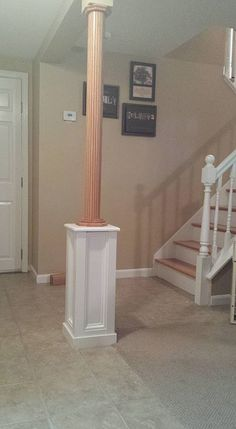 A special application of Pole-Wrap installed above a custom built pedestal. An attractive idea for covering basement support columns!