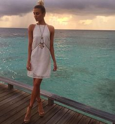Erin Holland soaking up the sun in the Maldives wearing the Carla Mini Dress, Monaco Body Chain and Caribbean Wedges, get the look in Boutiques and Online xx
