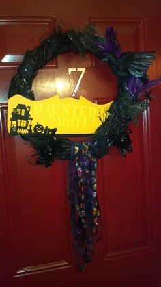 """Made with stuff primarily from Michael's. The sign is from the Dollar Tree and cost $.25. My flash washed it out, but it says """"Halloween Hotel."""""""