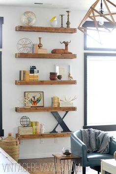 I love floating shelves ::: DIY Built In Shelving Living Room Makeover @ Vintage Revivals