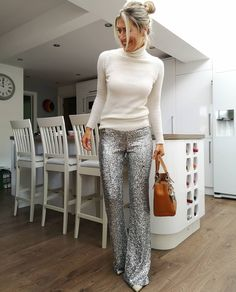 Turtleneck to worn with sequin pants | For more style inspiration visit 40plusstyle.com