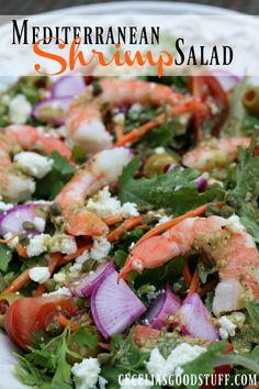Shrimp Mediterranean Salad layers and layers of flavor make this salad stand out. Topped with fresh shrimp and a lemon caper dressing making this a meal in itself! Healthy and fresh and perfect for a summer dinner option!   CeceliasGoodStuff.com | Good Food for Good People