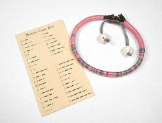 Morse code bracelet with morse code key- very cute idea.  Make a Wrapped Leather Secret Code Bracelet   Crafttuts+