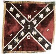 1st North Carolina Cavalry Regt Battle Flag. James B. Gordon, a Major in the 1st North Carolina Cav Regt at the beginning of the war, was promoted through the ranks and eventually became a Brigade Commander (commanding four N.C. Cavalry Regiments) under Gen Hampton's Div of Cav. Brig. Gen. Gordon suffered an arm wound in May 1864 at the battle of Yellow Tavern. The wound was not mortal but erysipelas set. He died a few days later. It is rumored that this same flag had draped the General's…