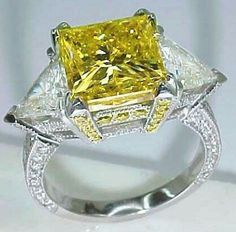 Canary Yellow Diamond and White Diamond ring Canary Yellow Diamonds, Canary Diamond, Colored Diamonds, White Diamonds, Three Stone Diamond Ring, Diamond Rings, Diamond Jewelry, Sapphire Jewelry, Sapphire Gemstone