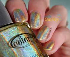 Kismet from the Color Club Halo Hues 2013 collection. This gorgeous linear holo is gold but appears almost yellow / green. I think Color Club do some of the best holographic nail polishes.