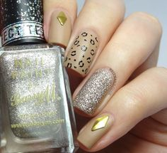 http://www.britnails.co.uk/2014/02/leopard-studs-and-glitter.html