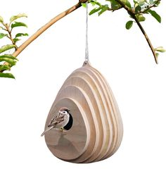 materials : plywood, natural oil colors : natural woo Organic shaped bird hose, it will blend smoothly with the natural surounding. Bird house made from birch plywood, it has a 50mm hole for birds to enter. The shape allows the rain water to run smoothly on its surface. size : W 190 mm x H 270 mm Hole size 50 mm
