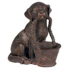 """Create a cozy fireplace vignette or greet guests at your doorway with this dog statuette, featuring a weathered finish and open basket.   Product: StatuetteConstruction Material: Composite woodColor: BrownDimensions: 13.75"""" H x 8.5"""" W x 11.5"""" D"""