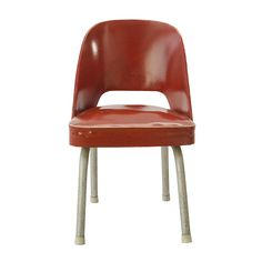 ERSA Chair_____ This red leather armchair without armrests was designed by Metin Atabey Ata in the 1950s. The chair`s legs, due to lack of materials in the day, with a creative solution, were produced of water pipes. Today it is preserved at the ERSA firm.