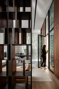 A walnut accent wall showcases a pair of floor-to-ceiling, temperature controlled wine fridges, Exterior Design, Interior And Exterior, Built In Bathtub, Custom Fireplace, Pivot Doors, Wood Stairs, Build Your Dream Home, Lounge Areas, Amazing Architecture