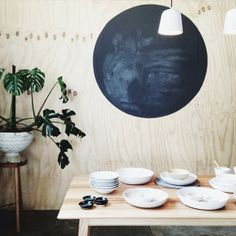 Simple plywood wall/black board spot idea seen at popandscott, from stephanie_somebody via The Design Chaser