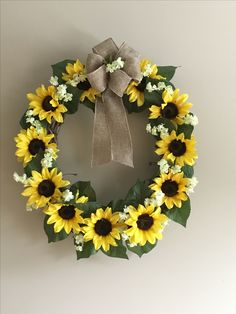 Beautiful sunflower wreath with burlap bow for my sunflower themed kitchen! My MIL made this with flowers from AC Moore, burlap ribbon from dollar tree, a vine wreath, and a hot glue gun! Approximately $22 for supplies. These sell for $60 in the craft stores!