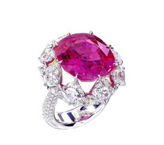 A 19.47 crt natural no_heat burmese pink sapphire ring surrounded by 16 cushion cut diamond totaling 12.51 crt by Forms jewellery