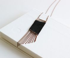 TRAPEZOIDAL black Pendant - Leather, Vintage brass tubes, geometric piece  http://www.etsy.com/listing/76297229/trapezoidal-black-pendant-leather