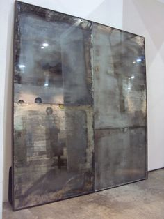 Vincenzo de Cotiis  DESIGNER: ARCHITECT VINCENZO DE COTIIS  ARTISTIC PANEL  Size: W_2600 D_2800 H_2800 mm  Object: Aged finish/look mirrors artistic panel - black wood framed  Material: Aged finish/look mirrors; black wood frames  Type: Prototype/unique piece  Country: Italy  Year of realization: 2007